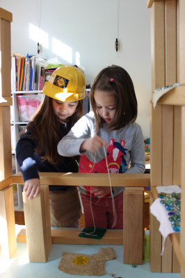 Children worked over several days to understand how pulling down on the string makes the drawbridge go up.